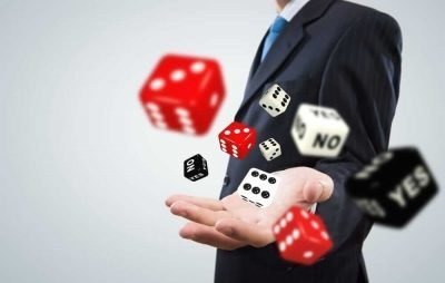 man holding dice - gambling addiction - Compassionate Interventions