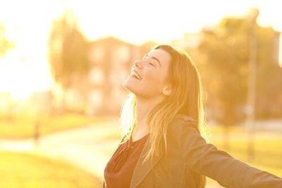 Happy woman - spiritual entity - Compassionate Interventions